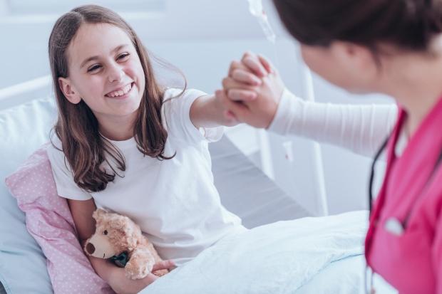 smiling-girl-in-the-hospital-PQM572L.jpg